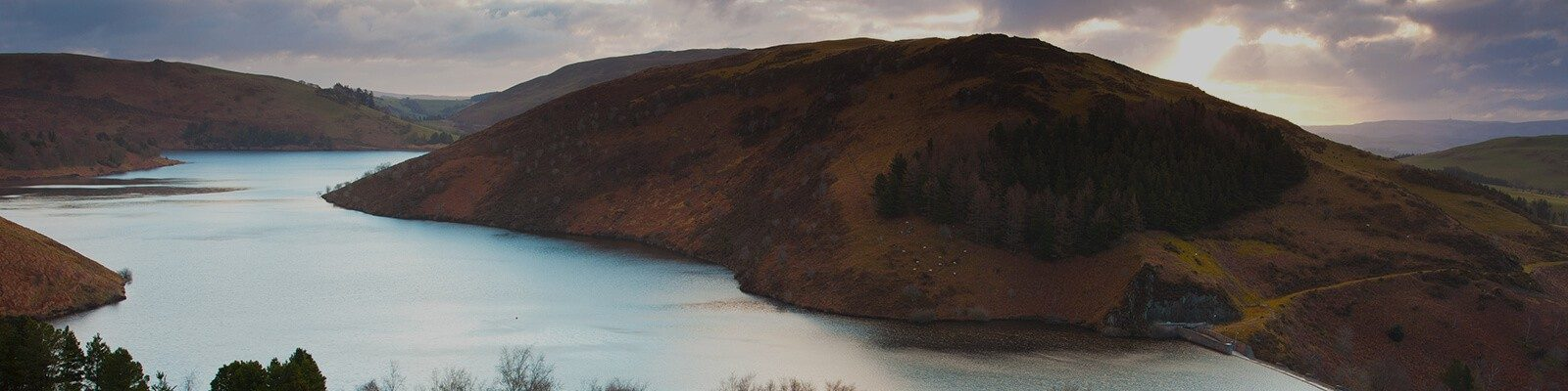 banner image of water and hills.